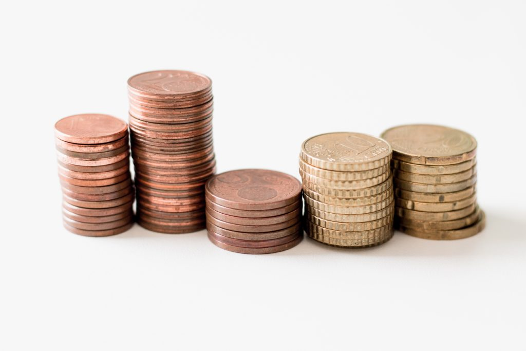 Close-up of stacks of coins against a white background