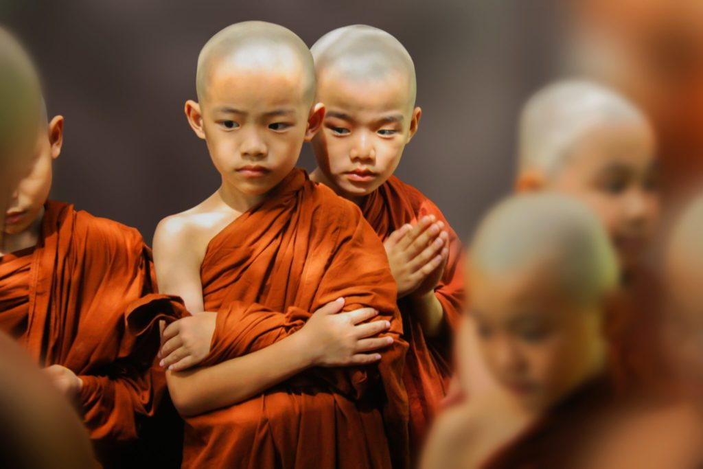 Two child monks looking serious